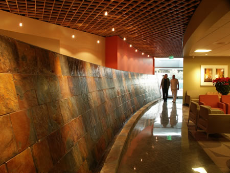 Soothing waterfall in Lucy Curci Cancer Center lobby